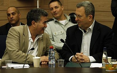 Then defense minister Ehud Barak, right, sits next to MK Amir Peretz as he attends the Foreign Affairs and Defense Committee meeting in the Knesset on March 19, 2012. (Uri Lenz/Flash 90)