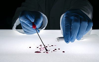 Illustrative image of forensic evidence being gathered at a crime scene (natasaadzic; iStock by Getty Images)