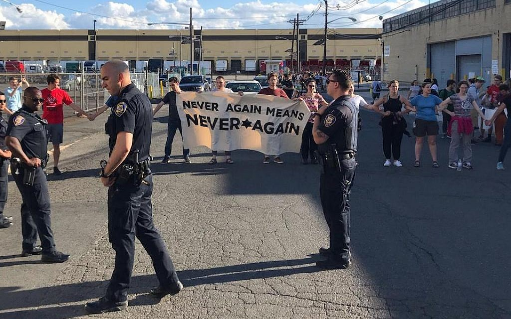 Police stand in front of protesters at a demonstration at an ICE detention center in Elizabeth, New Jersey, June 30, 2019. (Naftali Y. Ehrenkranz via JTA)