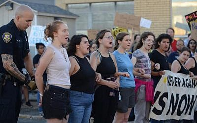 Members of the group Never Again Action are arrested protesting migrant dtention policies in Boston on July 2, 2019. (Gili Getz via JTA)