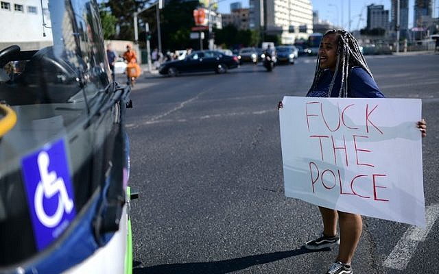 Ethiopian Israelis protest following the death of 19-year-old Ethiopian, Solomon Tekah who was shot and killed few days ago in Kiryat Haim by an off-duty police officer, in Tel Aviv, July 2, 2019. (Tomer Neuberg/Flash90)