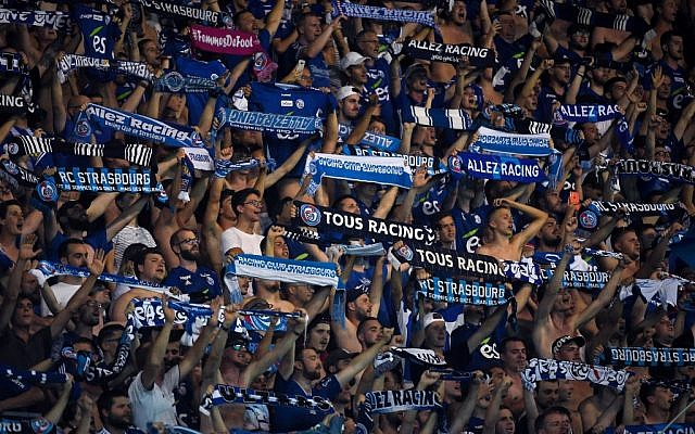Strasbourg's supporters cheer for their team during the UEFA Europa League preliminary round football match on July 25, 2019. (PATRICK HERTZOG / AFP)