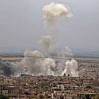This file photo taken on May 23, 2019 shows smoke rising following reported Syrian government bombardment on the town of Khan Sheikhoun in the southern countryside of the rebel-held Idlib province. (Anas Al-Dyab/AFP)