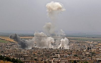 This file photo taken on May 23, 2019 shows smoke rising following reported Syrian government bombardment on the town of Khan Sheikhun in the southern countryside of the rebel-held Idlib province. (Anas Al-Dyab/AFP)