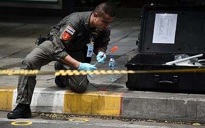 A policeman conducts an investigation at the scene of an explosion in Bangkok on August 2, 2019. (Lillian SUWANRUMPHA / AFP)