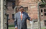 US civil rights activist Jesse Jackson touches a barbed wire fence at the former Nazi death camp Auschwitz-Birkenau to commemorate 75 years since the killings of the Sinti and Roma at the camp in Oswiecim, on August 2, 2019. (Alik Keplicz/AFP)