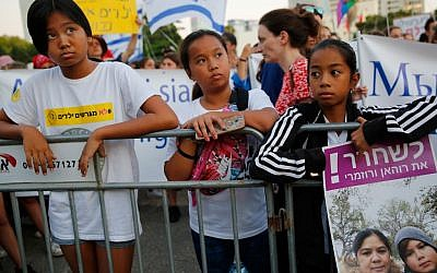 Filipino children carry banners during a protest against deportation in Tel Aviv on August 6, 2019. (Gil COHEN-MAGEN / AFP)