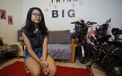 11-year-old Sivan, the daughter of Filipina domestic worker Ramela Noel, speaks during an interview at her home in Tel Aviv on August 6, 2019. (Gil COHEN-MAGEN / AFP)