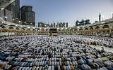 Mulism pilgrims perform prayers around the Kaaba, Islam's holiest shrine, at the Grand Mosque in Saudi Arabia's holy city of Mecca on August 7, 2019, prior to the start of the annual Hajj pilgrimage in the holy city.  (Abdel Ghani BASHIR / AFP)