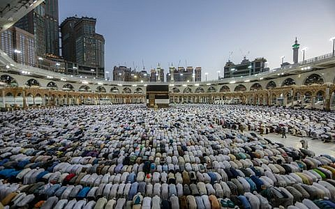 Mulism pilgrims perform prayers around the Kaaba, Islam's holiest shrine, at the Grand Mosque in Saudi Arabia's holy city of Mecca on August 7, 2019, prior to the start of the annual Hajj pilgrimage in the holy city.  (Abdel Ghani Bashir/ AFP)