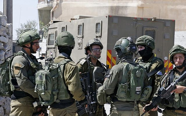 Israeli soldiers stand guard during a house-to-house search operation in the West Bank village of Beit Fajjar near Bethlehem on August 8, 2019, following a stabbing attack that killed Dvir Sorek, 19 (HAZEM BADER / AFP)