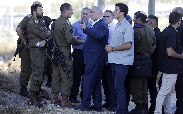 Israel's Prime Minister Benjamin Netanyahu inspects the site where an off-duty Israeli soldier was found dead with stab wounds near the settlement of Migdal Oz in the  West Bank on August 8, 2019. (MENAHEM KAHANA / AFP)