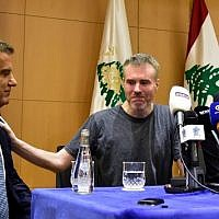 Kristian Lee Baxter (C), a Canadian formerly held captive by the Syrian government, pats the shoulder of the Lebanese Head of General Security Major-General Abbas Ibrahim (L), during a press conference with Canada's ambassador to Lebanon Emanuelle Lamoureux (R), following Baxter's release after an eight-month captivity, in the Lebanese capital Beirut on August 9, 2019. (Photo by MOHAMMAD AL-SAHILI / AFP)
