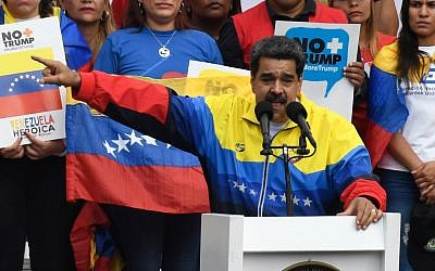 """Venezuela's President Nicolas Maduro delivers a speech during the """"No more Trump"""" march to protest US sanctions in Caracas on August 10, 2019. (Federico Parra/AFP)"""