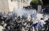 Israeli security forces clash with Muslim worshipers at the Temple Mount compound in the Old City of Jerusalem on August 11, 2019. (Ahmad Gharabli/AFP)