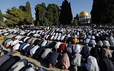 Muslim worshipers perform the Eid al-Adha morning prayers at the Temple Mount in the Old City of Jerusalem on August 11, 2019. (Ahmad Gharabli/AFP)