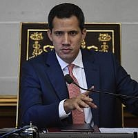 Venezuelan opposition leader and self-proclaimed acting president Juan Guaido takes part in a legislative session at the National Assembly in Caracas on August 13, 2019. (Federico Parra/AFP)