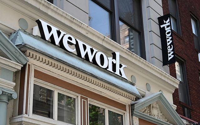 WeWork posts $900m loss as it plots stock market listing