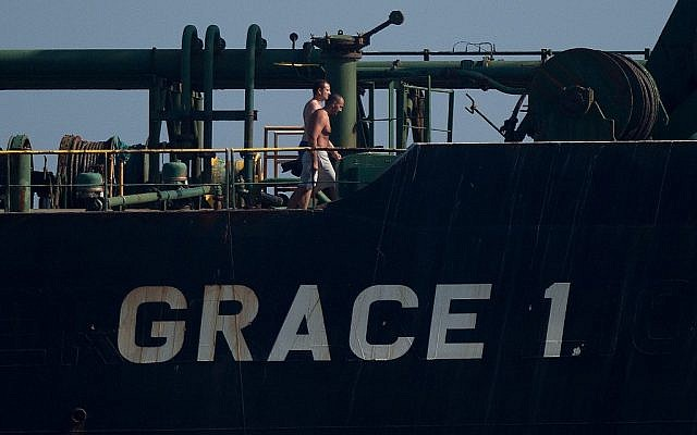 Crew members of Iranian supertanker Grace 1 walk on board off the coast of Gibraltar on August 15, 2019. (JORGE GUERRERO / AFP)