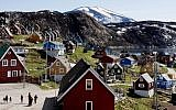 A picture taken on July 11, 2015, shows houses in Upernavik, a small village in western Greenland. (Linda Kastrup / Ritzau Scanpix / AFP)