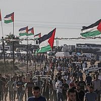 Palestinians demonstrate near the fence along the border with Israel in the eastern Gaza Strip on August 16, 2019. (Mahmud Hams/AFP)