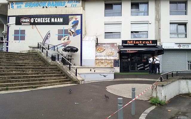 French policemen stand in front of the eatery where a waiter was shot dead by a customer allegedly angry at having to wait for a sandwich, in the eastern Paris suburb of Noisy-le-Grand on August 17, 2019. (Tiphaine LE LIBOUX / AFP)