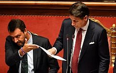 Italian Prime Minister Giuseppe Conte (R), beside Deputy Prime Minister and Interior Minister Matteo Salvini, delivers a speech at the Italian Senate, in Rome, on August 20, 2019, as the country faces a political crisis (Andreas SOLARO / AFP)