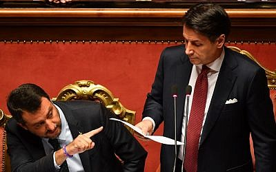 Italian Prime Minister Giuseppe Conte (R), flanked by Deputy Prime Minister and Interior Minister Matteo Salvini (L), delivers a speech at the Italian Senate in Rome on August 20, 2019, as the country faces a political crisis. (Andreas Solaro/AFP)