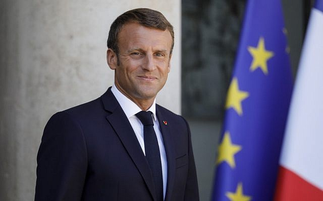French President Emmanuel Macron waits for the arrival of Britain's Prime Minister Boris Johnson ahead of a meeting at The Elysee Palace in Paris on August 22, 2019. (Geoffroy Van Der Hasselt/AFP)