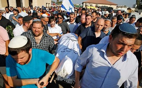 Mourners carry away the body of 17-year-old Israeli Rina Shnerb, who was killed in a homemade bomb terror attack while visiting a spring near Dolev in the West Bank, during her funeral in the city of Lod on August 23, 2019. (Photo by Jack GUEZ / AFP)
