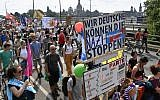 "Protesters take part in a demonstration titled ""Unteilbar"" (indivisible) against exclusion on August 24, 2019 in Dresden, eastern Germany. (John MACDOUGALL/AFP)"