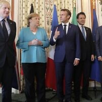 (L-R) Britain's Prime Minister Boris Johnson, German Chancellor Angela Merkel, French President Emmanuel Macron, Italian Premier Giuseppe Conte and President of the European Council Donald Tusk pose during a G7 coordination meeting with the Group of Seven European members at the Hotel du Palais in Biarritz, southwestern France on August 24, 2019. (Markus Schreiber/POOL/AFP)