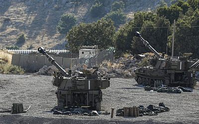 This picture taken on August 25, 2019 from the Israeli side of the Golan Heights shows self-propelled artillery guns positioned along the border with Syria. (Jalaa MAREY / AFP)