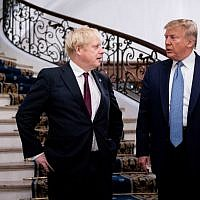 US President Donald Trump (R) and Britain's Prime Minister Boris Johnson speak before a working breakfast at the G7 Summit in Biarritz, France, on August 25, 2019. (Erin Schaff / POOL / AFP)