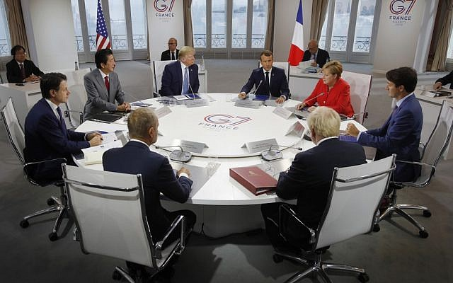 From left to right: Italy's Prime Minister Giuseppe Conte, Japan's Prime Minister Shinzo Abe, European Council President Donald Tusk, US President Donald Trump, France's President Emmanuel Macron, Britain's Prime Minister Boris Johnson, Germany's Chancellor Angela Merkel and Canada's Prime Minister Justin Trudeau attend a working session at the G-7 summit in Biarritz, southwest France, on August 25, 2019. (Philippe Wojazer/Pool/AFP)