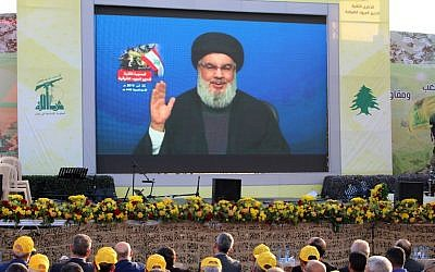 Hezbollah supporters watch a televised speech by the Lebanese terror group's leader Hassan Nasrallah, in the town of Al-Ain in Lebanon's Bekaa valley, on August 25, 2019. (AFP)