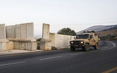An Israeli military vehicle patrols on the Israeli-Lebanese border near the village of Ghajar on August 26, 2019. (JALAA MAREY / AFP)