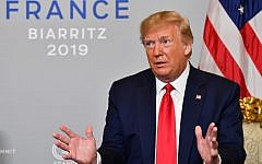US President Donald Trump meets with Egyptian President Abdel-Fattah el-Sissi in Biarritz, southwest France on August 26, 2019, on the third day of the annual G7 Summit. (Photo by Nicholas Kamm / AFP)