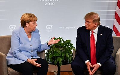 German Chancellor Angela Merkel, left, and US President Donald Trump speak during a bilateral meeting on the third day of the annual G7 Summit in Biarritz, south-west France, August 26, 2019. (Nicholas Kamm/AFP)