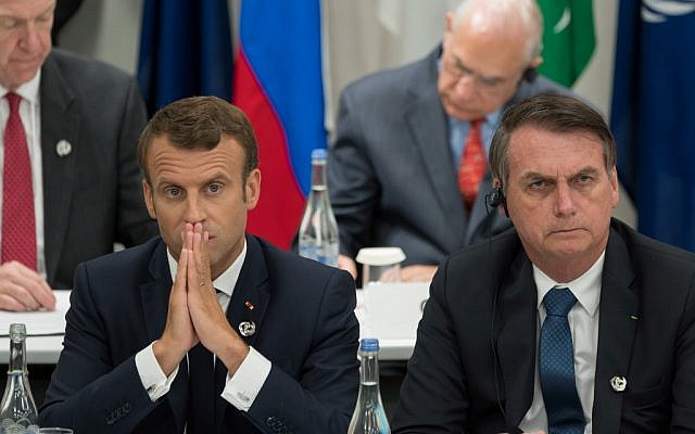 France's President Emmanuel Macron, left, and Brazil's President Jair Bolsonaro attend a meeting on the digital economy at the G20 Summit in Osaka, Japan, June 28, 2019. (Jacques Witt/POOL/AFP)