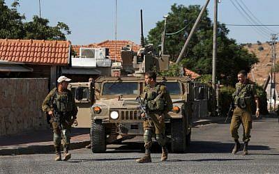 Israeli soldiers patrolling near the northern Israeli town of Avivim, close to the border with Lebanon, August 26, 2019. (JALAA MAREY / AFP)