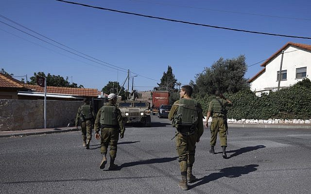 A picture taken on August 26, 2019, shows Israeli soldiers patrolling near the northern Israeli town of Avivim, close to the border with Lebanon. (JALAA MAREY / AFP)