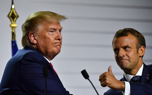 US President Donald Trump, left, and French President Emmanuel Macron gesture during a joint press conference on August 26, 2019, the third day of the annual G7 Summit in Biarritz, south-west France. (Nicholas Kamm /AFP)