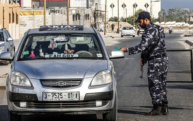 Hamas security forces stop a vehicle at a checkpoint in Khan Younis in the southern Gaza Strip on August 28, 2019 (Said Khatib/AFP)