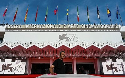 An employee works outside the Palazzo del Cinema on August 28, 2019 on the opening day of the 76th Venice Film Festival at Venice Lido. (Alberto Pizzoli/AFP)