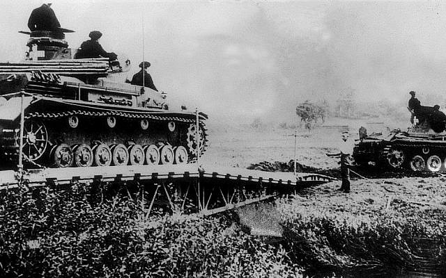 In this file photo taken on September 6, 1939, Germans tanks cross a river into Polish territory. Nazi forces invaded Poland from the west on September 1, 1939, prompting Britain and France to declare war on Berlin two days later. Soviet forces attacked Poland from the east on September 17, under a secret pact with Germany, and the city of Warsaw surrendered 10 days later. (AFP)