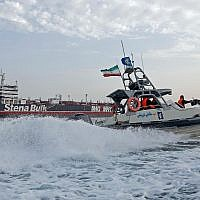 Iranian Revolutionary Guards patrol around the British-flagged tanker Stena Impero while it is anchored off the Iranian port city of Bandar Abbas, on July 21, 2019. (Hasan Shirvani / MIZAN NEWS AGENCY / AFP)