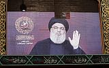 A speech by Hezbollah chief Hassan Nasrallah is transmitted on a large screen in Beirut's southern suburbs on August 31, 2019. (Anwar Amro/AFP)
