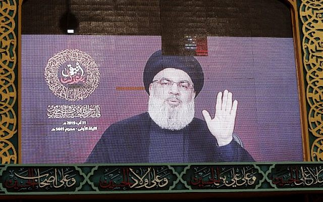 A speech by Hezbollah chief Hassan Nasrallah is transmitted on a large screen in the Lebanese capital Beirut's southern suburbs on August 31, 2019. (Anwar Amro/AFP)
