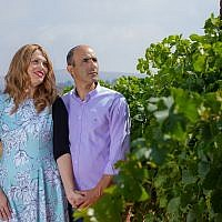 Vered and Erez Ben Sa'adon in a vineyard of Tura Winery, which they founded in 2003 in the West Bank settlement of Rechelim (courtesy Tura Winery)
